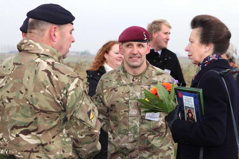 A soldier speaks with Princess Anne