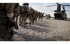 Troops board a Chinook at Camp Bastion