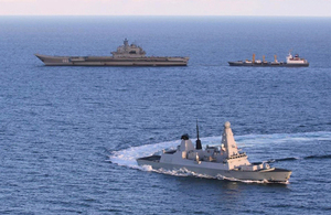 HMS Defender with the Russian aircraft carrier Admiral Kuznetsov and a resupply ship [Picture: Crown copyright]