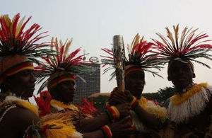 Traditional Dancers from the Centre Region pose with the Baton
