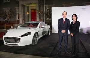 Ambassador Sebastian Wood and Jenny Zheng, Regional Director of Aston Martin China next to Aston Martin Centenary Edition model in Residence grounds
