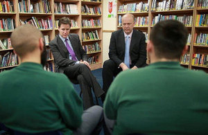Image of Nick Clegg and Chris Grayling talking to young offenders provided by Peter Macdiarmid/Getty Images