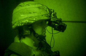 A soldier using the head-mounted night-vision system [Picture: Andrew Linnett, Crown copyright]
