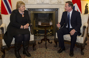 Prime Minister David Cameron talks with newly elected Norwegian Prime Minister Erna Solberg.