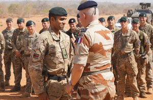 Rifleman Gigar Das receives his lance corporal's stripe from General Bertrand Ract-Madoux in Mali [Picture: Crown copyright]