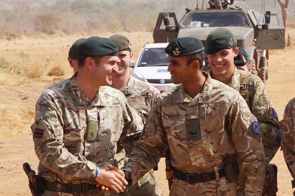 Major Sam Cates congratulates Lance Corporal Gigar Das