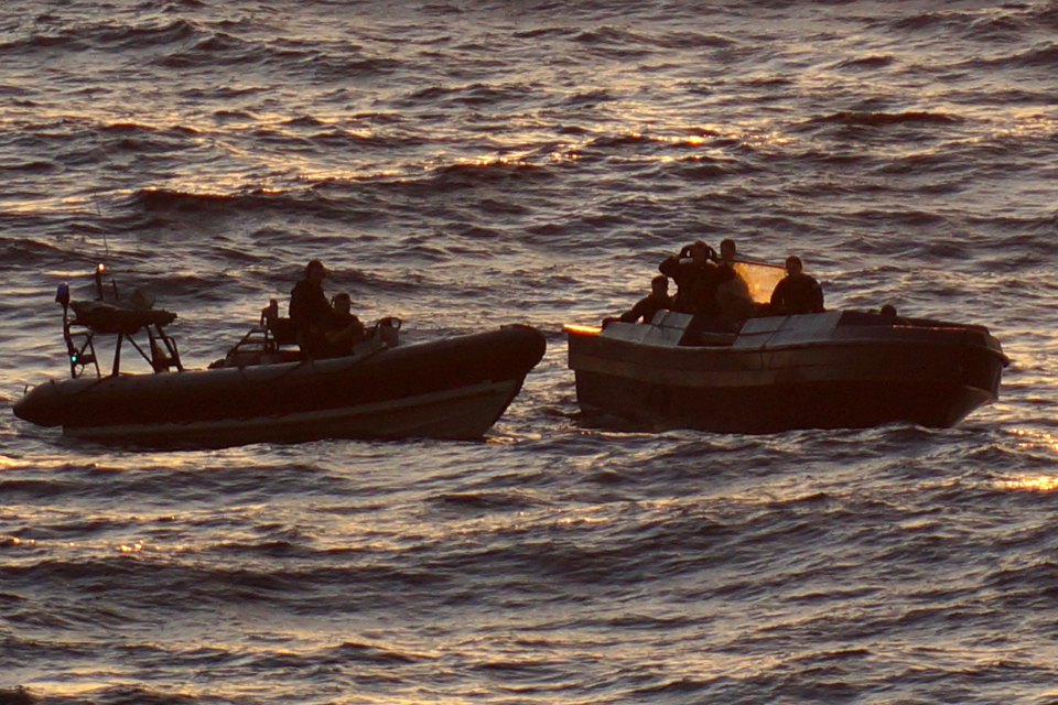 The 25-foot speedboat (right) seized by the United States Coast Guard and RFA Wave Knight