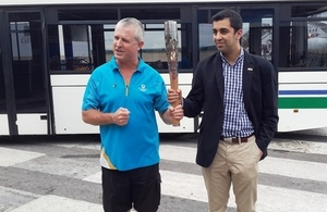 Scottish Minister arrives in Zambia and shows off Queen's Baton