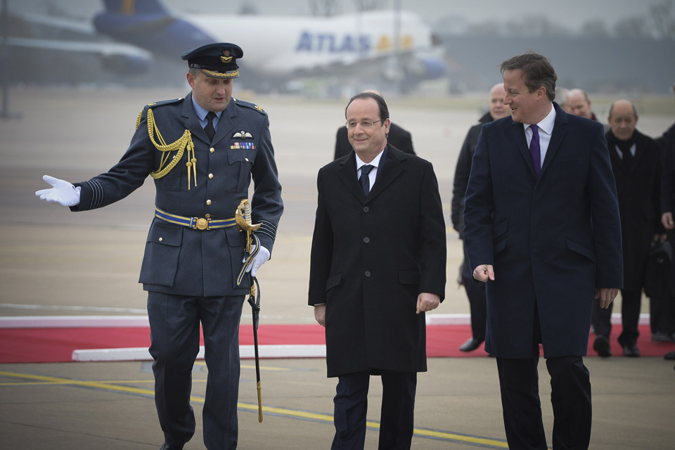 Group Captain Stephen Lushington welcomes the Prime Minister and the French President