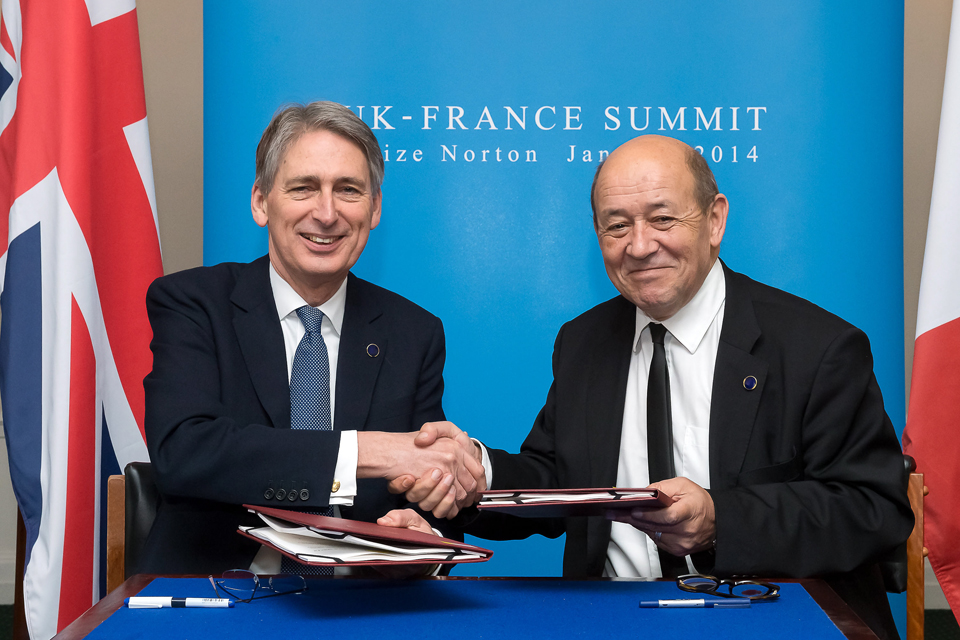 Philip Hammond shakes hands with the French Defence Minister