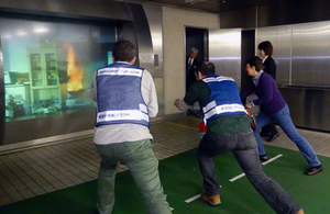 'kaji da!' Participants practice putting out fires at Tachikawa Life Safety Learning Center