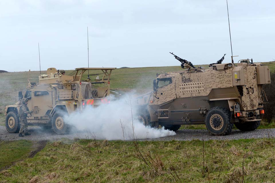 Soldiers practise extracting an immobilised Foxhound vehicle