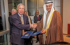 Earl Howe and His Excellency Dr Ali Saad Al-Obaidi, Minister of Health for Kuwait, sign the Memorandum of Understanding at Arab Health in Dubai
