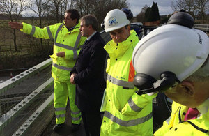 Robert Goodwill visiting the M2 hole location with workers