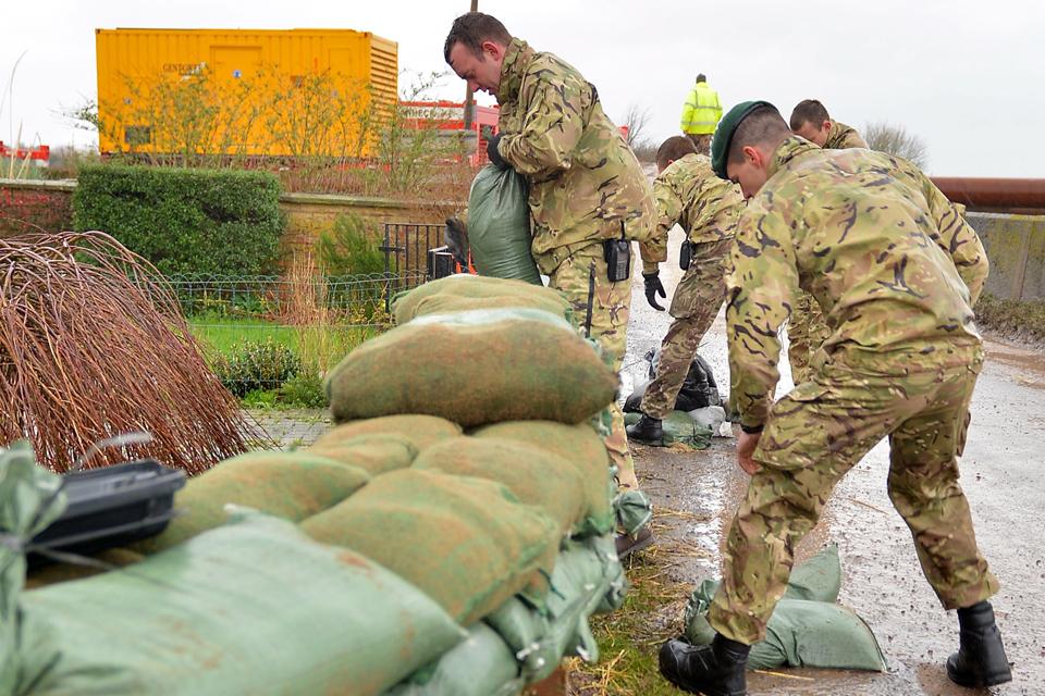 Royal Marines laying sandbags