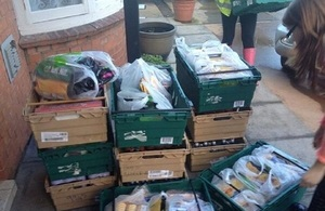Boxes of food being delivered by volunteers