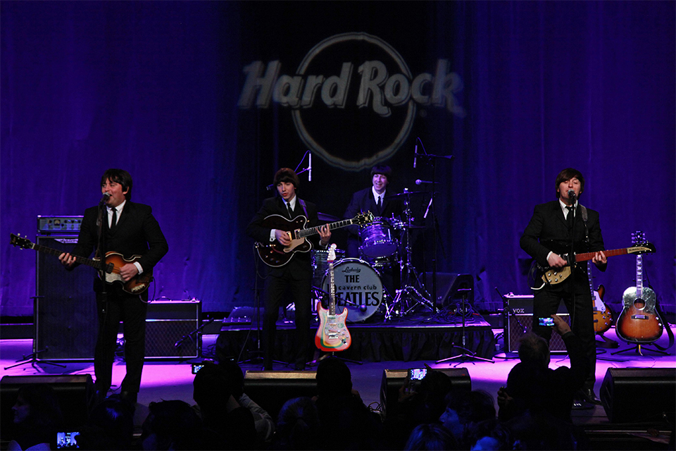 The Cavern Club Beatles perform at the Hard Rock Cafe in New York. Photo by Martin Roe.