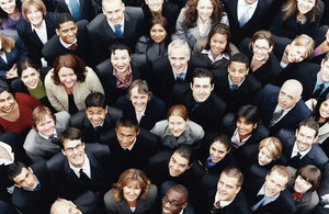 Business people standing in a crowd