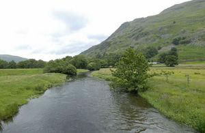 A river runs through fields