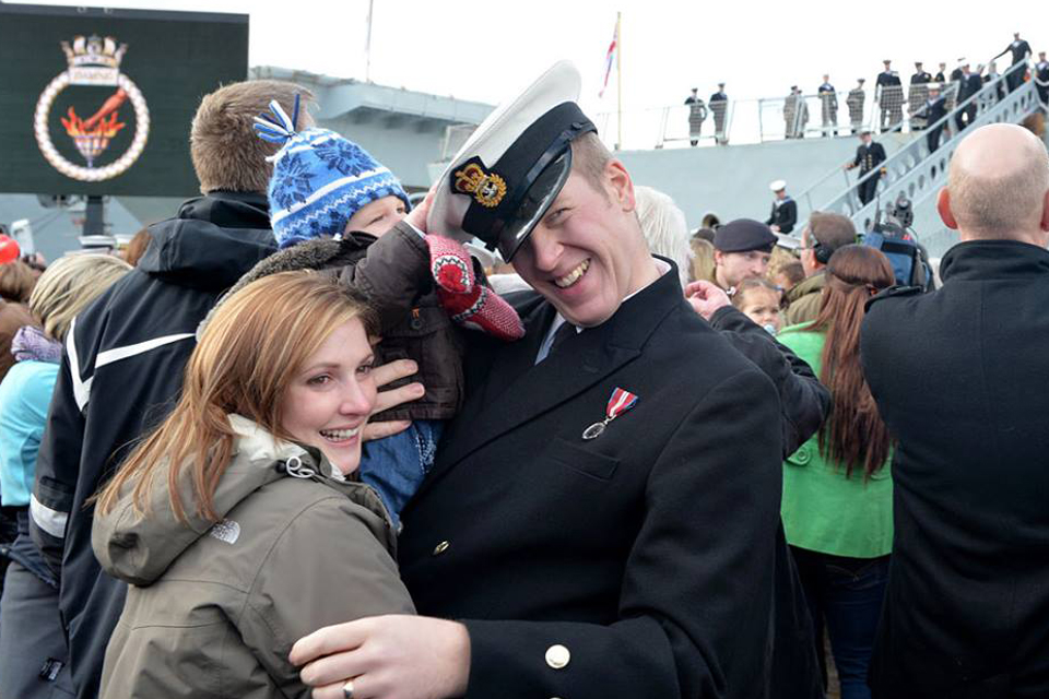 A chief petty officer is welcomed home