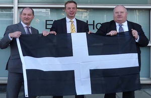Stephens Williams, Stephen Gilbert and Eric Pickles with the Cornwall flag.