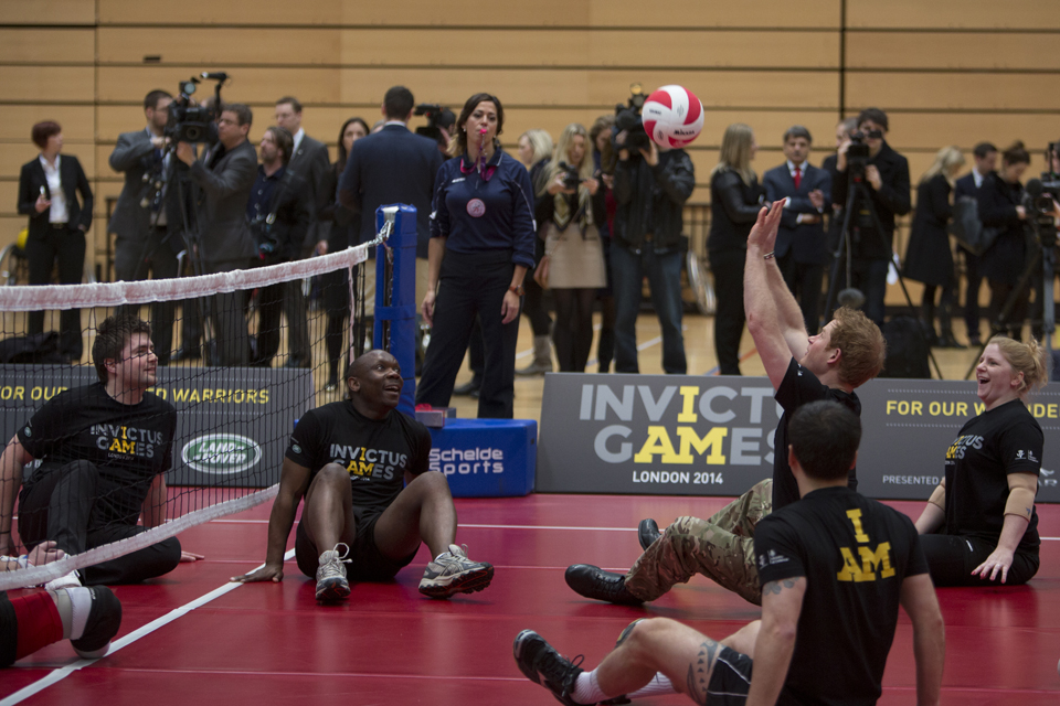 Prince Harry joins in with a sitting volleyball game at the launch of the Invictus Games