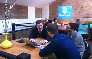 David Gauke shows Grabble founders Daniel Murray and Joel Freeman the Employment Allowance online calculator.