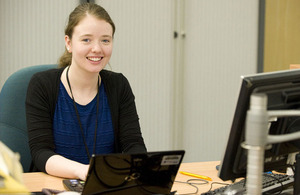 Kelly Dunlea sitting at desk