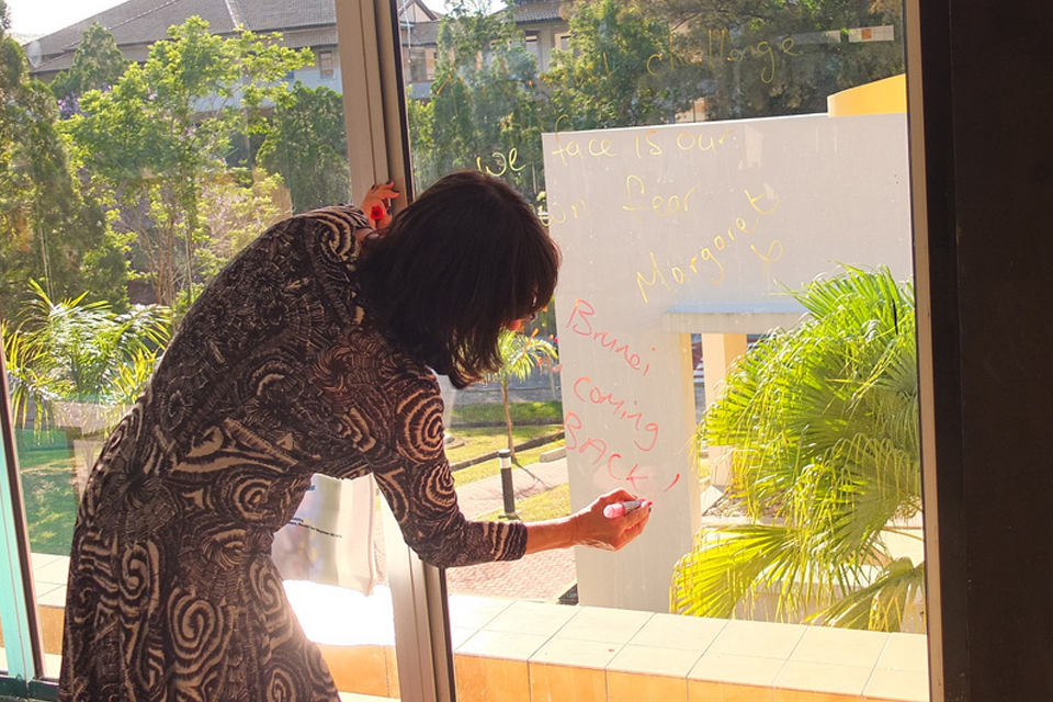 "Margaret writes her quote on the E@C window: ""The biggest challenge that we face is our own fear"""