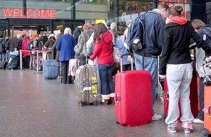 Passengers queuing in Heathrow Airport