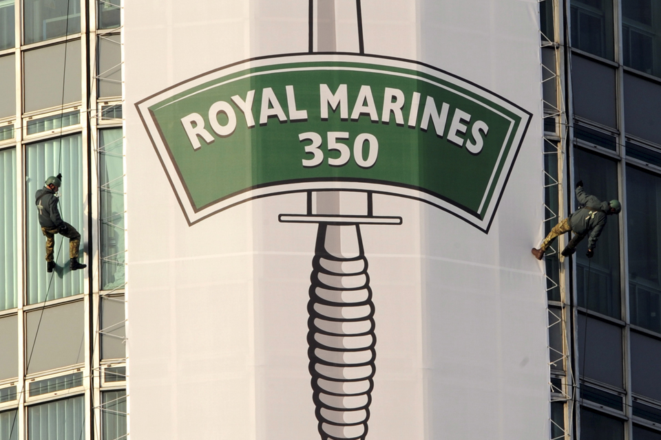 Two Royal Marines abseiling down the iconic BT Tower