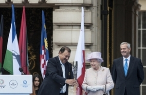 HM Queen Elizabeth II putting a message in the baton on 09 October 2013 in London