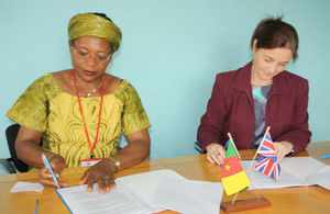 Deputy British High Commissioner, Allison Marriott signing project funding contract with representative of Cameroon's minister of Women's Empowerment and promotion .of the family.