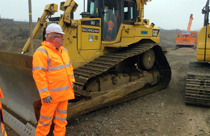 Transport Secretary Patrick McLoughlin surveys the work to build a new line at Bicester
