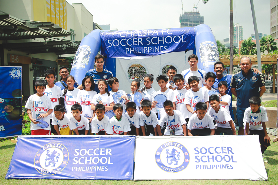 Group photo of the members of the Chelsea FC Soccer School Philippines including Azkal Players Phil and James Younghusband and the children who participated in the football drills