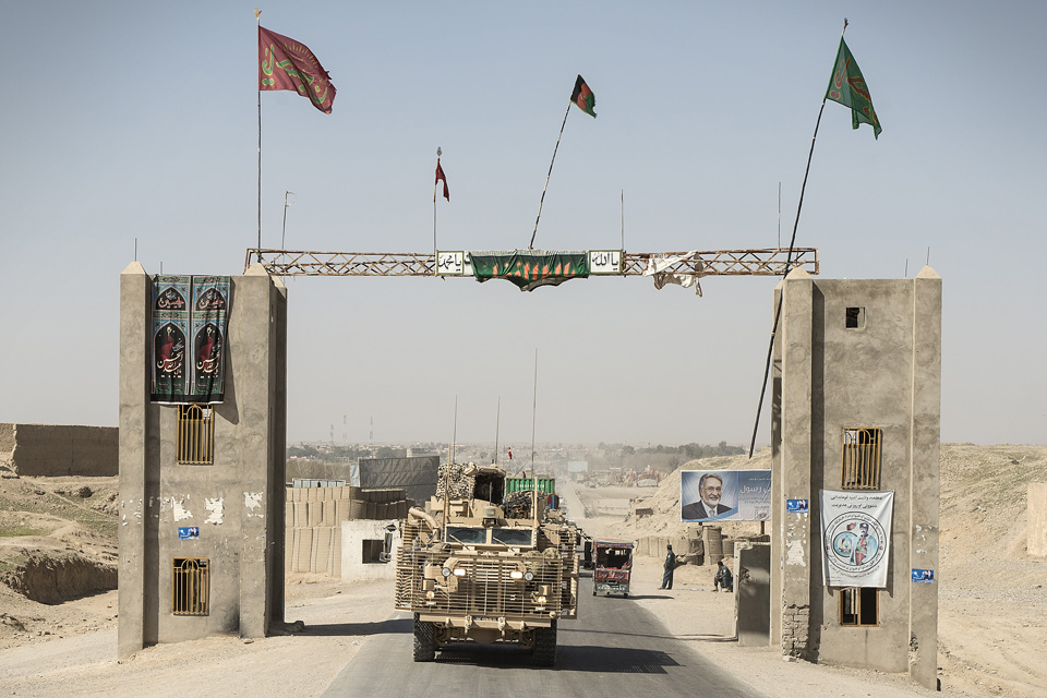 Vehicles from 2 Logistic Support Regiment take equipment back to Camp Bastion
