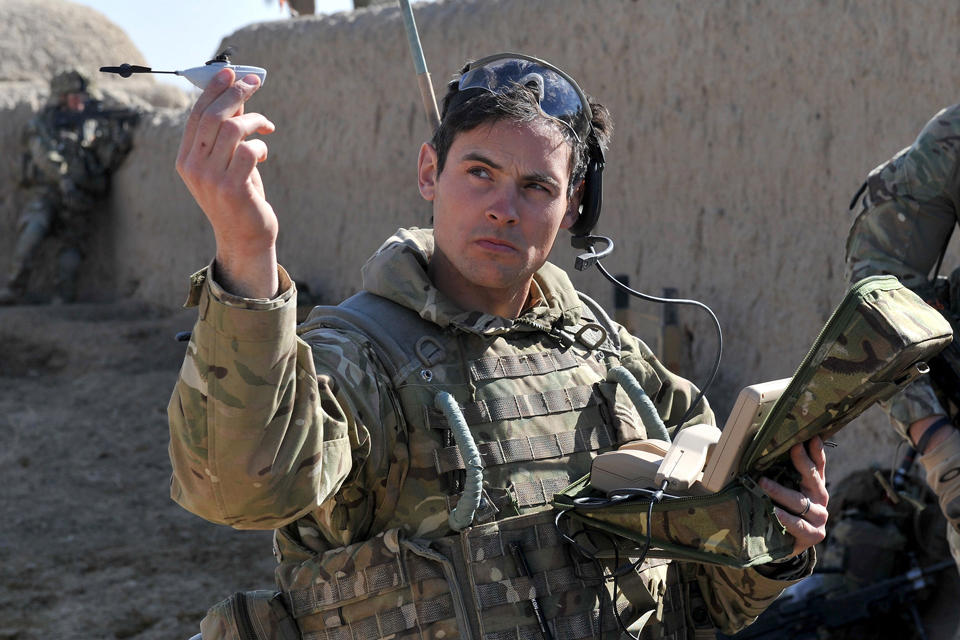 Soldier with a Black Hornet nano unmanned aerial system