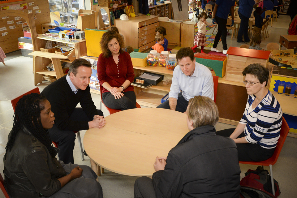 David Cameron and Nick Clegg on a childcare visit