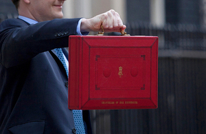 Chancellor holding the red Budget box