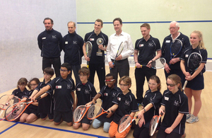 The Deputy Prime Minister posing with squash players