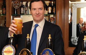 Chancellor holding a pint of ale