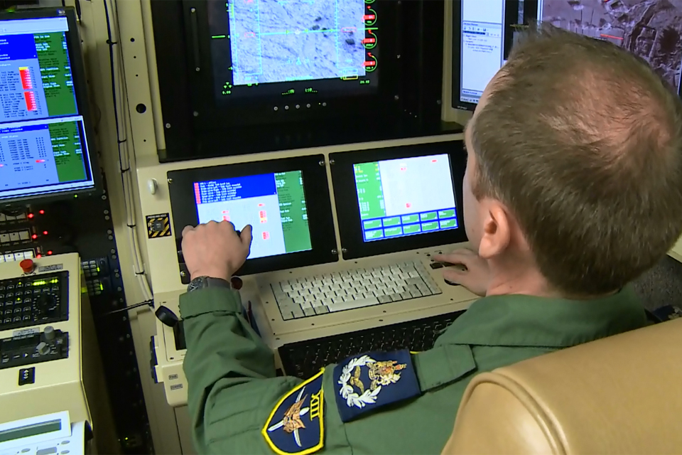 A pilot from 13 Squadron remotely controls a Reaper aircraft