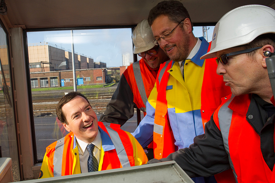 The Chancellor learns how to drive a train during his visit to the Tata steel factory in Port Talbot, South Wales.