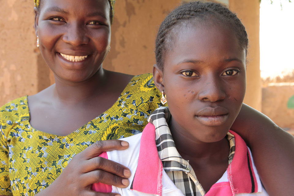 Asseta (left) with one of her daughters. Picture: Jessica Lea/DFID