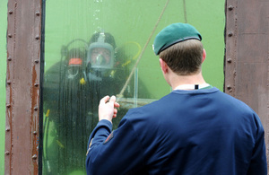 A British Army diver in a tank during a demonstration at Upavon airfield [Picture: Richard Watt, Crown copyright]