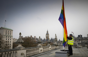 Rainbow flag being raised over 70 Whitehall