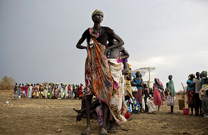 Women displaced by conflict in South Sudan queue to collect food rations in the town of Mingkaman, March 2014. Picture: UNICEF/Kate Holt