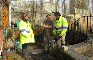 environment agency staff talking to resident