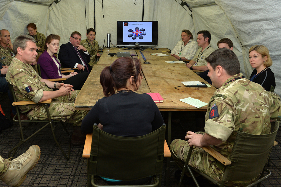 Mark Francois receives a briefing from members of the Combined Joint Task Force Headquarters