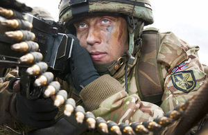 A paratrooper from 16 Air Assault Brigade takes up a defensive position on arrival at the Kinloss airfield [Picture: Senior Aircraftwoman Tracey Dobson, Crown copyright]